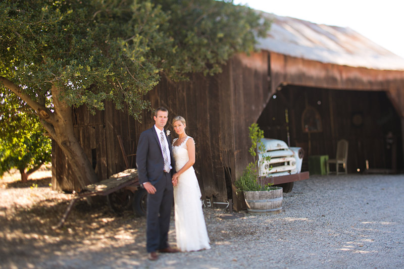 San Luis Obispo Wedding, bride and groom standing in front of Dana Powers Barn