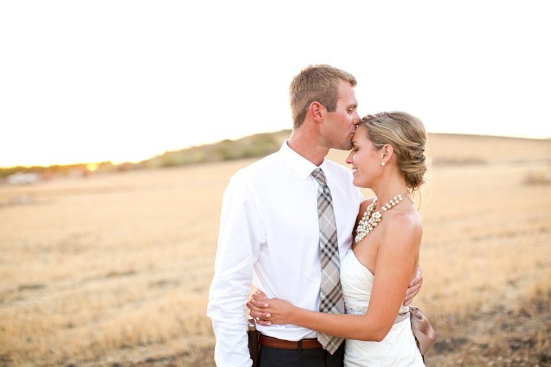 San Luis Obispo, Dana Powers Barn Wedding, groom kissing brides forehead in an open field at twilight.