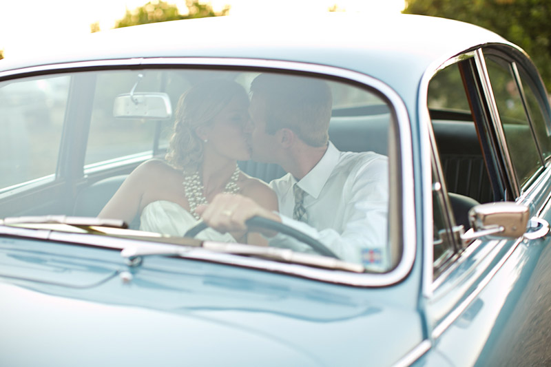 San Luis Obispo, Dana Powers Barn Wedding, bride and groom sitting in classic Jaguar kissing in front seat, car from Cars With Distinction.