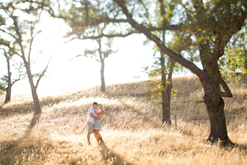 san luis obispo engagement photos, couple kissing in a field