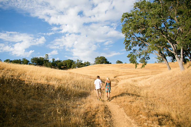 san luis obispo engagement photos, couple walking in a field