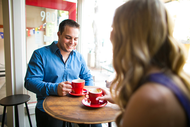 San Luis Obispo Engagement pictures of couple drinking coffee at cafe out of a red cup. (2 of 2)
