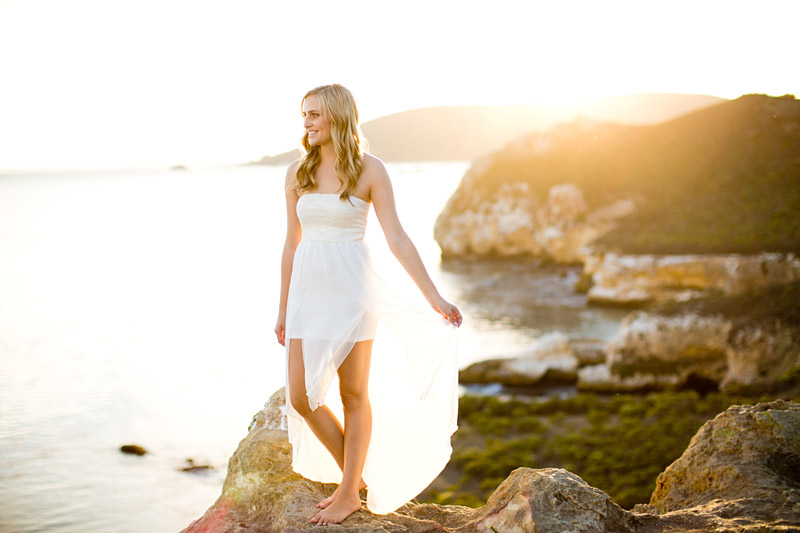 Avila Beach Engagement pictures of bride in flowing white dress on the cliffs overlooking Avila Bay.