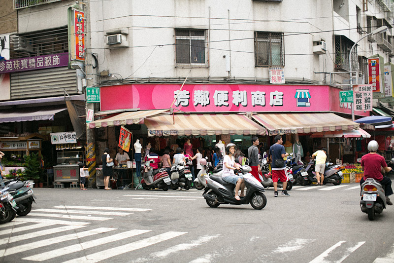 Taiwan street market with scooters.