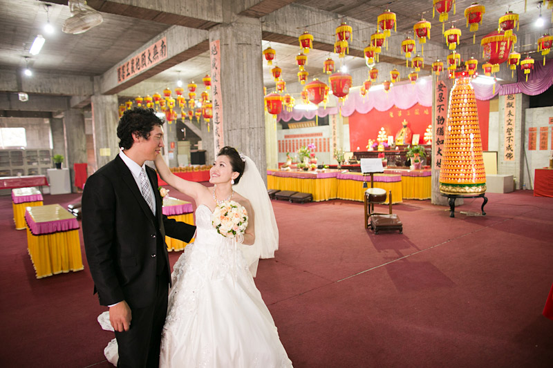 Taiwan wedding. Bride and groom in temple before ceremony.