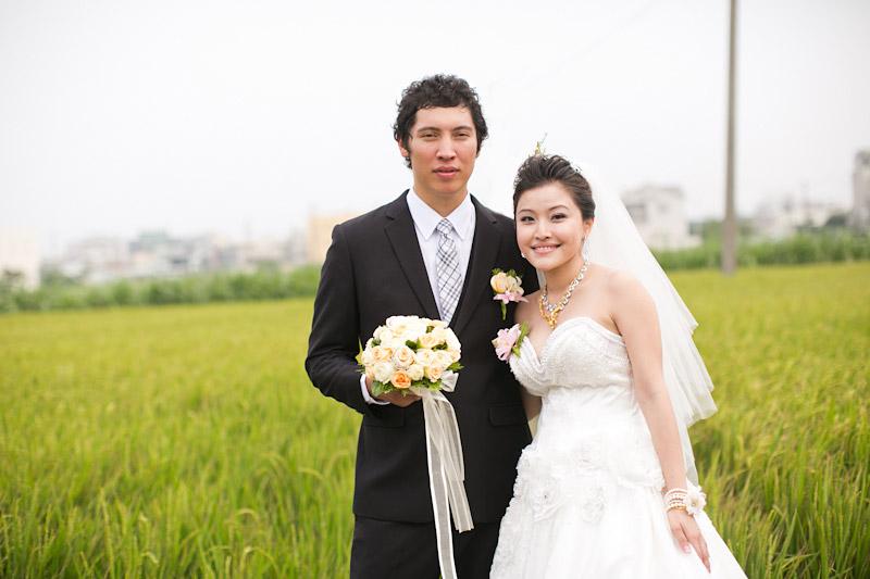 Taiwan wedding. Couple in rice field.