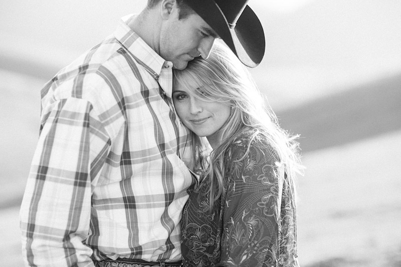 Central Coast Ranch Engagement romantic picture of cowboy hugging his girl by Cameron Ingalls.