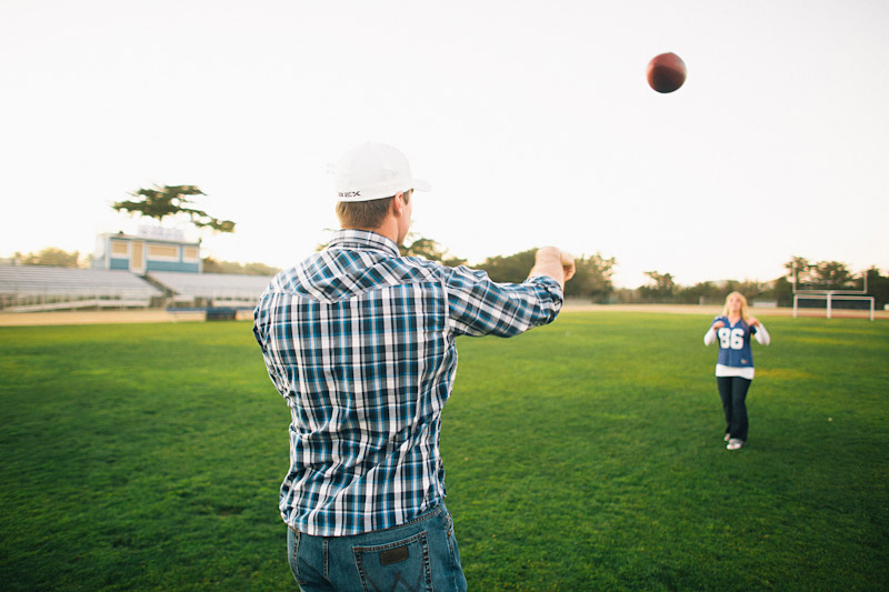 Morro Bay High School Engagement picture of Bear Pascoe of NY Giants & fiancé playing football by Cameron Ingalls. (2 of 3)