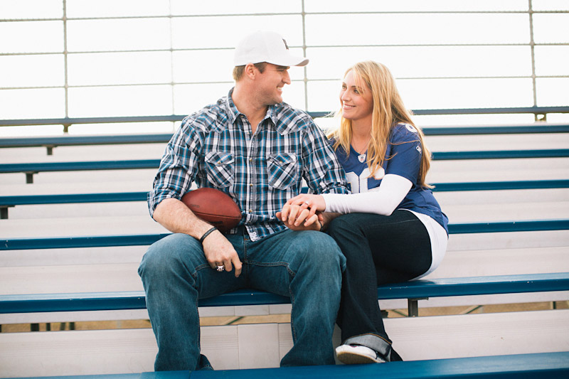 Morro Bay High School Engagement picture of Bear Pascoe of NY Giants & fiancé sitting in bleachers by Cameron Ingalls.