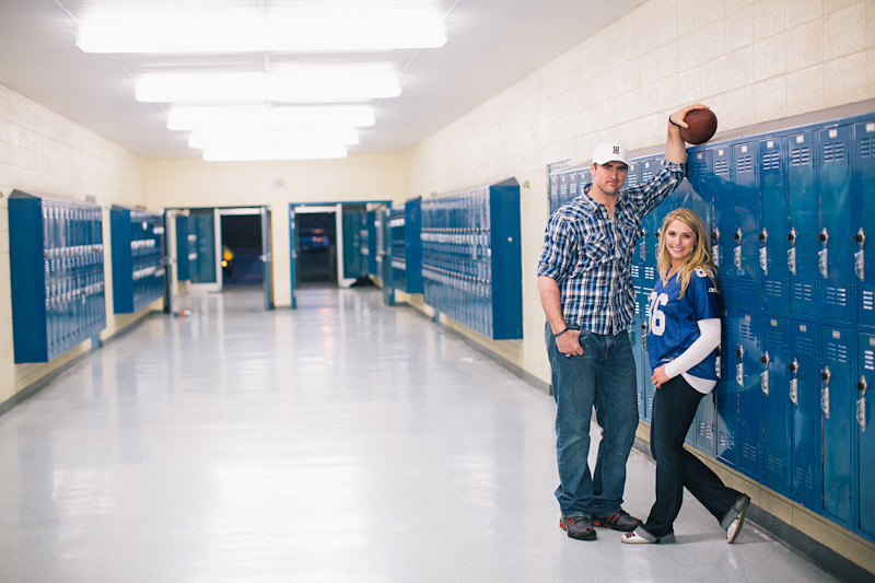Morro Bay High School Engagement picture of Bear Pascoe of NY Giants & fiancé standing by blue lockers by Cameron Ingalls.
