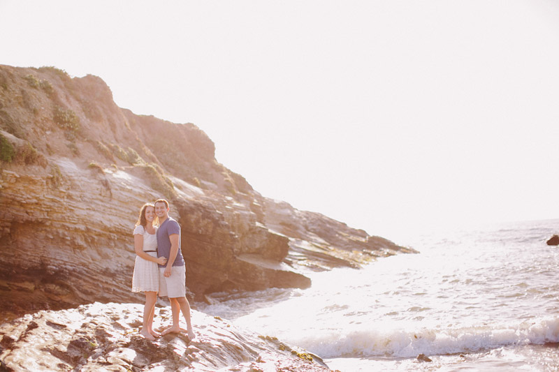 Montana De Oro, couple standing on a rock hugging by the ocean