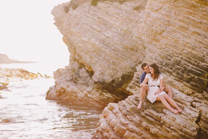 Montana De Oro, couple sitting on rock (1 of 2)