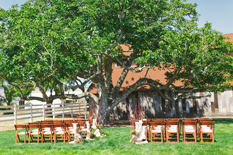 Central Coast rustic ranch wedding venue, Greengate ranch, chairs set up in front of barn.
