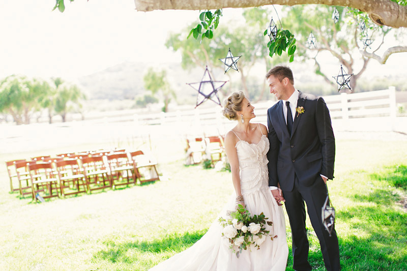 Central Coast rustic ranch wedding venue, Greengate ranch, wedding couple under oak tree at ceremony site.