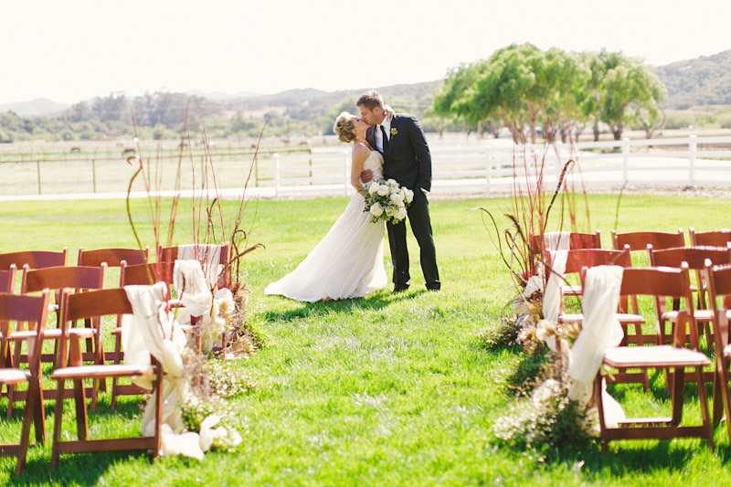 Central Coast rustic ranch wedding venue, Greengate ranch, couple kissing at ceremony site.