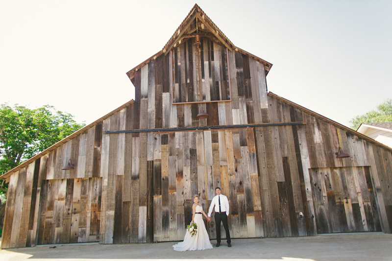 Central Coast rustic ranch wedding venue, Greengate ranch, couple holding hands in front of barn.