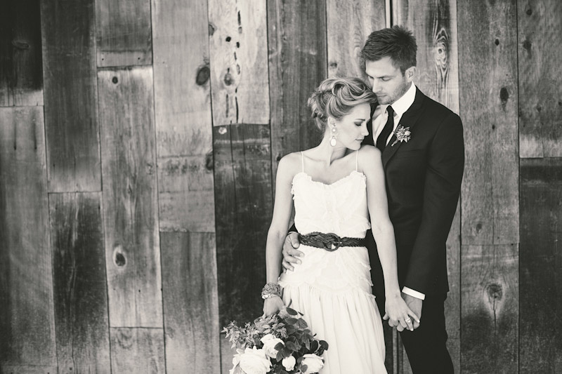 Central Coast rustic ranch wedding venue, Greengate ranch, bride and groom in front of barn.