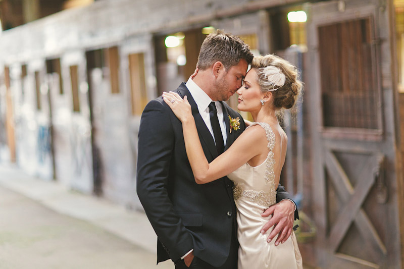 Central Coast rustic ranch wedding venue, Greengate ranch, bride& groom in horse barn eyes closed.