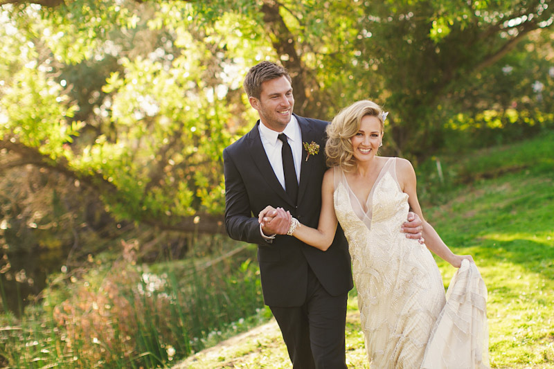 Central Coast rustic ranch wedding venue, Greengate ranch, bride and groom walking near pond.