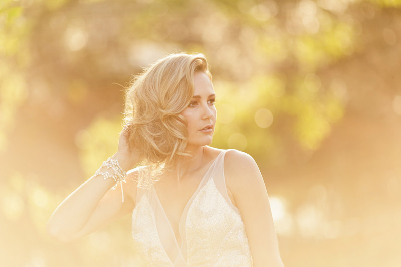 Central Coast rustic ranch wedding venue, Greengate ranch, bride touching her hair in full sun.