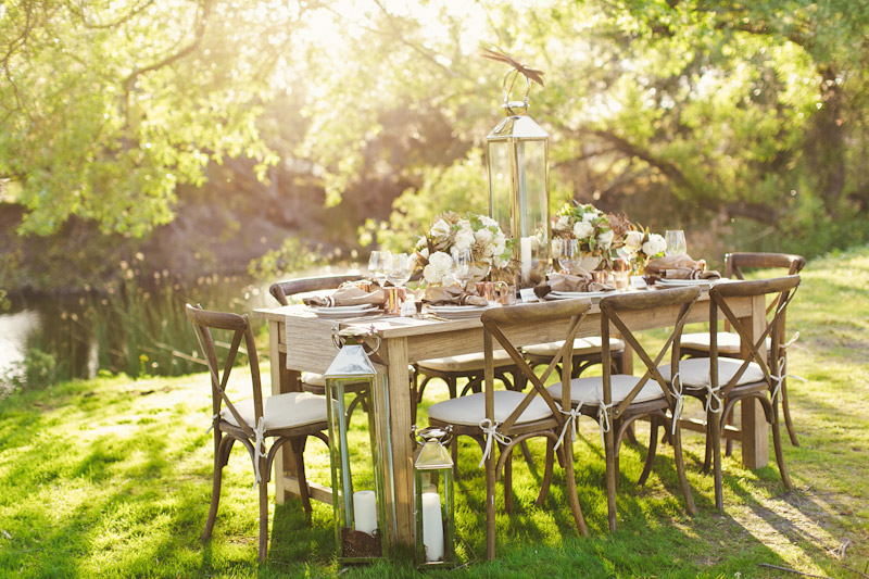 Central Coast rustic ranch wedding venue, Greengate ranch, dinner table setting with flowers and plates near pond.