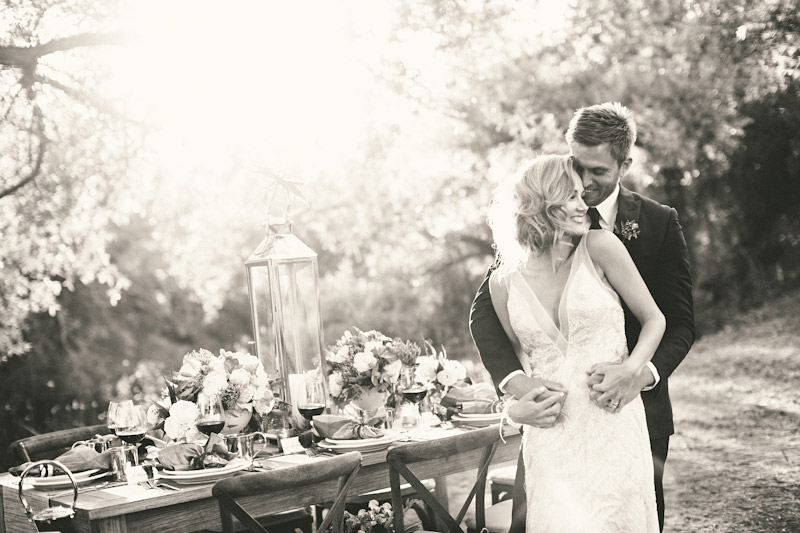 Central Coast rustic ranch wedding venue, Greengate ranch, table setting, bride and groom hugging near dinner table next to pond.
