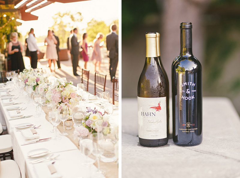 Carmel wedding, Carmel Valley Ranch, table details with guests mingling in the background and bottles of wine.