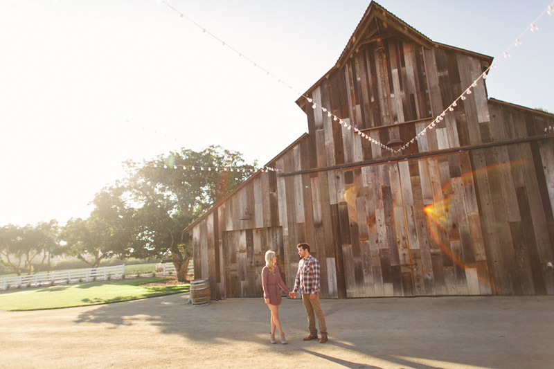 Greengate Ranch, Edna Valley, Couple in front of barn holding hands.