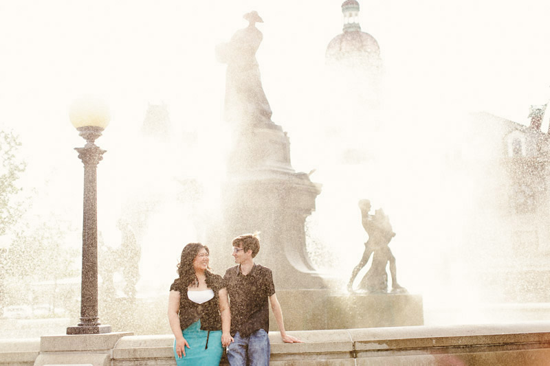 Montreal, Canada, couple standing in front of a water fountain