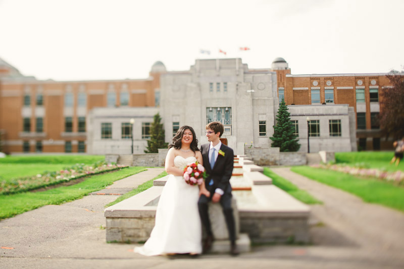 Montreal, Canada, bride and groom sitting outside of building