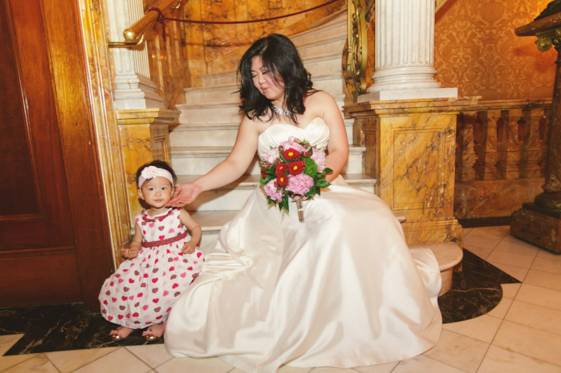 Montreal, Canada, bride and little girl on stairs