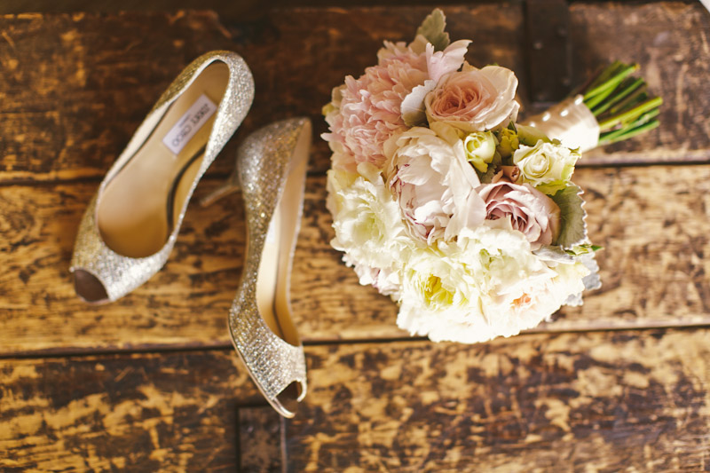 Carmel wedding, Carmel Valley Ranch, jimmy choo shoes and bouquet on old chest.