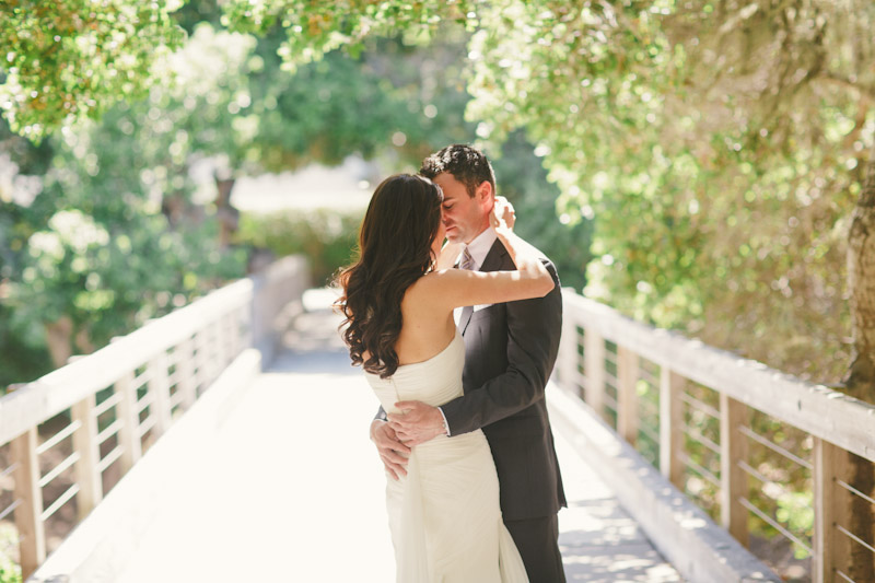 Carmel wedding, Carmel Valley Ranch, bride and groom seeing each other for the first time on bride under trees.