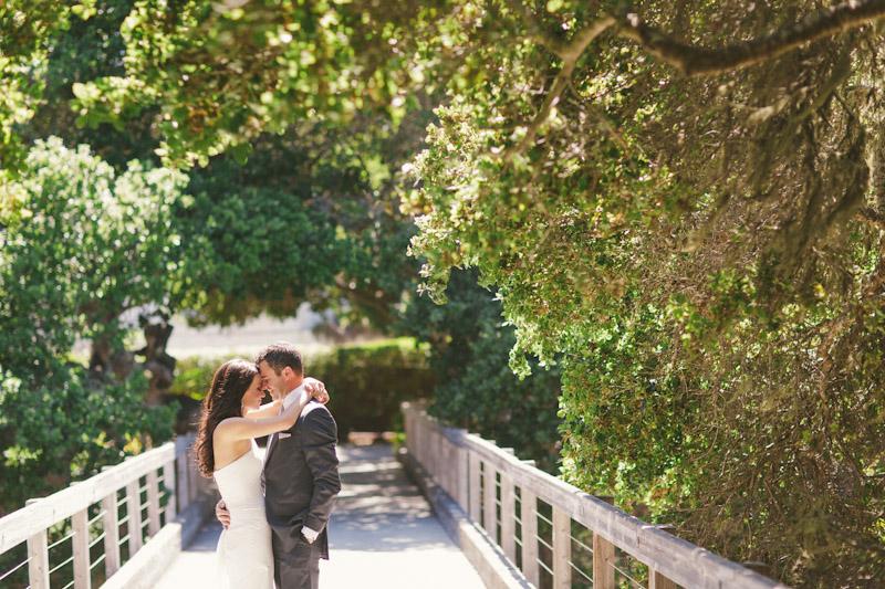 Carmel wedding, Carmel Valley Ranch, bride and groom hugging on bride under trees.
