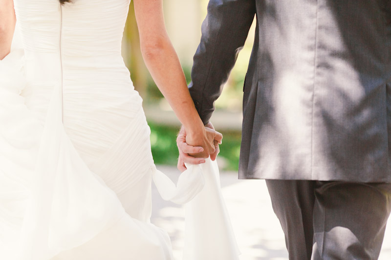 Carmel wedding, Carmel Valley Ranch, closeup of bride and groom holding hands.