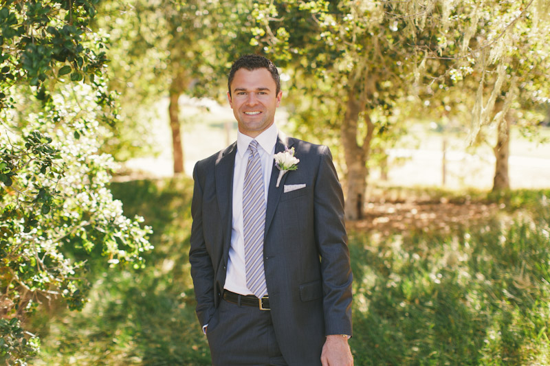 Carmel wedding, Carmel Valley Ranch, groom surrounded by trees.