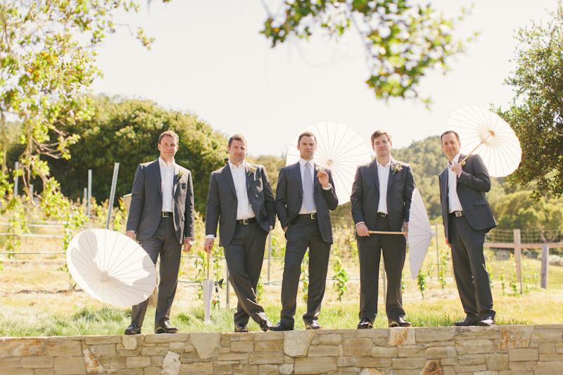 Carmel wedding, Carmel Valley Ranch, groom & groomsmen holding umbrellas.