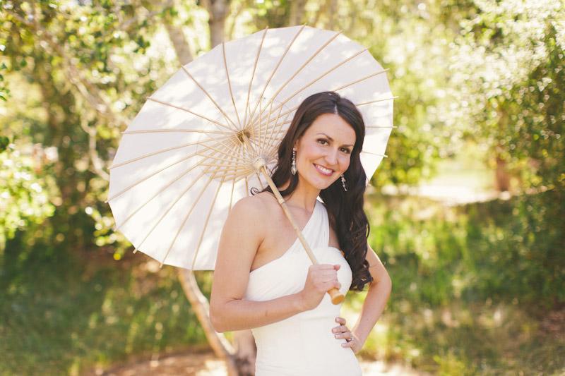 Carmel wedding, Carmel Valley Ranch, bride surrounded by trees holding umbrella.