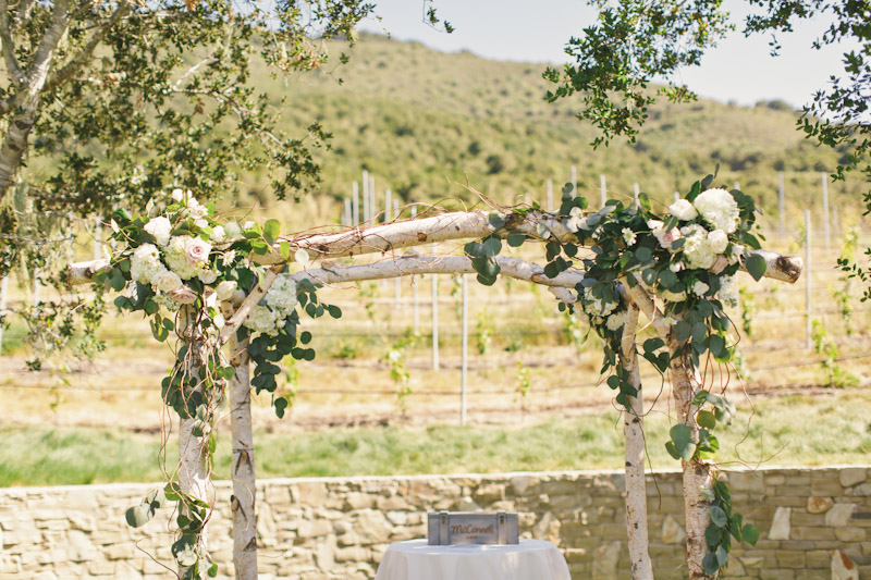 Carmel wedding, Carmel Valley Ranch, hoopa made of birch tree branches and flowers.