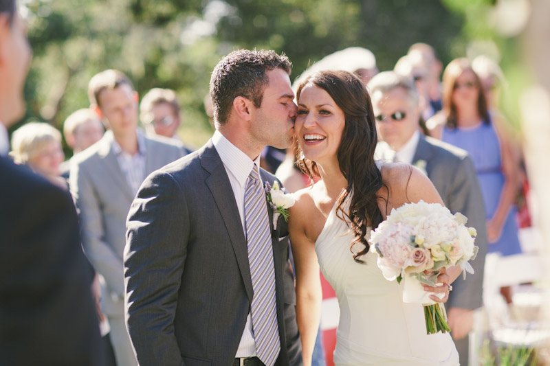 Carmel wedding, Carmel Valley Ranch, groom meeting his bride at front of the ceremony giving her a kiss on the cheek.