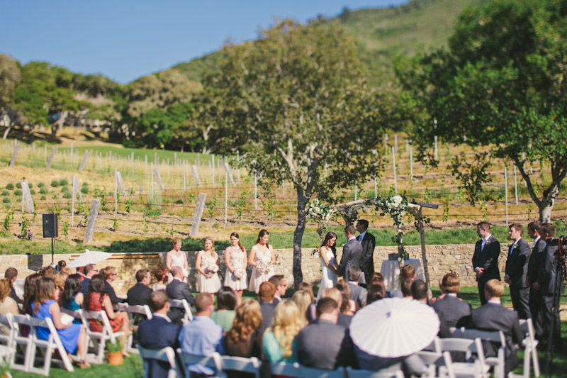 Carmel wedding, Carmel Valley Ranch, ceremony site on lawn in surrounded by vineyard.