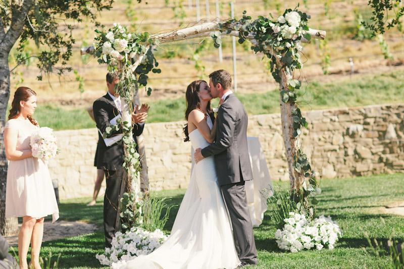 Carmel wedding, Carmel Valley Ranch, vineyard ceremony site, bride & groom's first kiss.