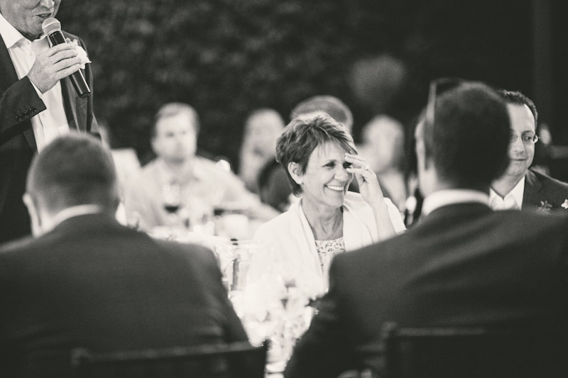 Carmel wedding, Carmel Valley Ranch,  mother of bride laughing during father of bride speech.
