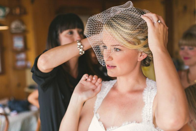 Cayucos Creek Barn, bride putting on veil