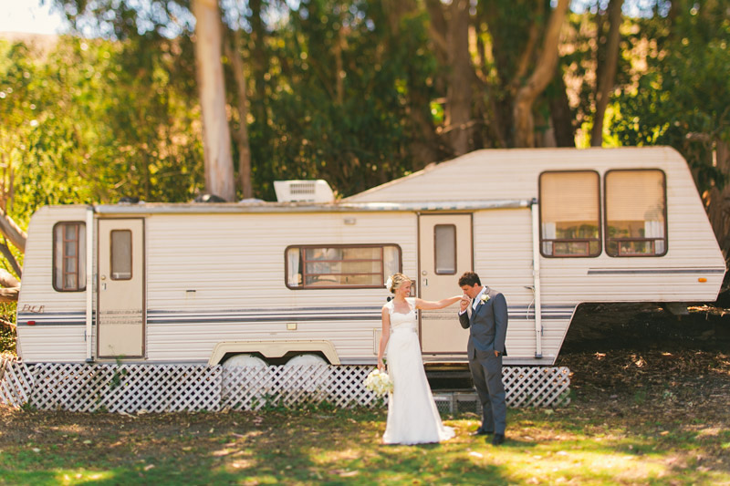 Cayucos Creek Barn, groom kissing brides hand