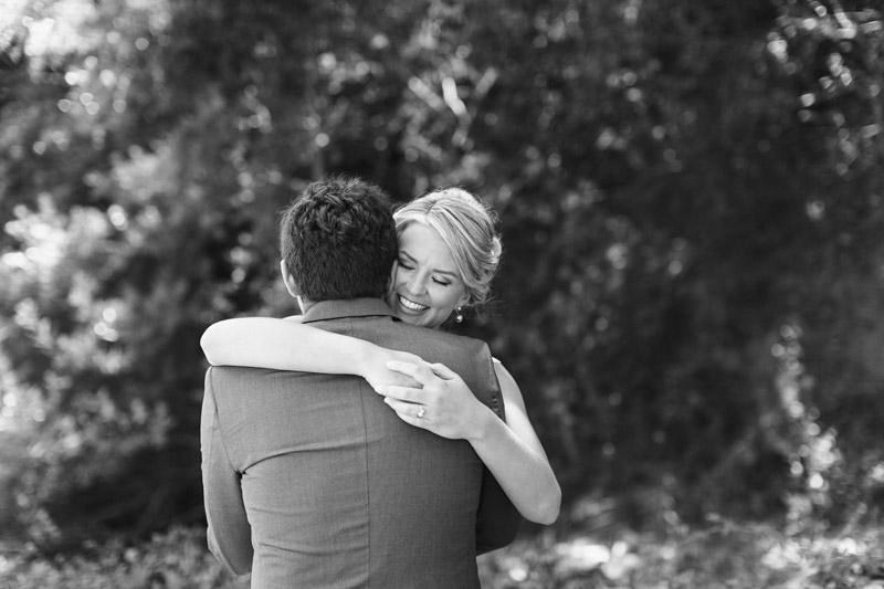 Cayucos Creek Barn, bride and groom hugging