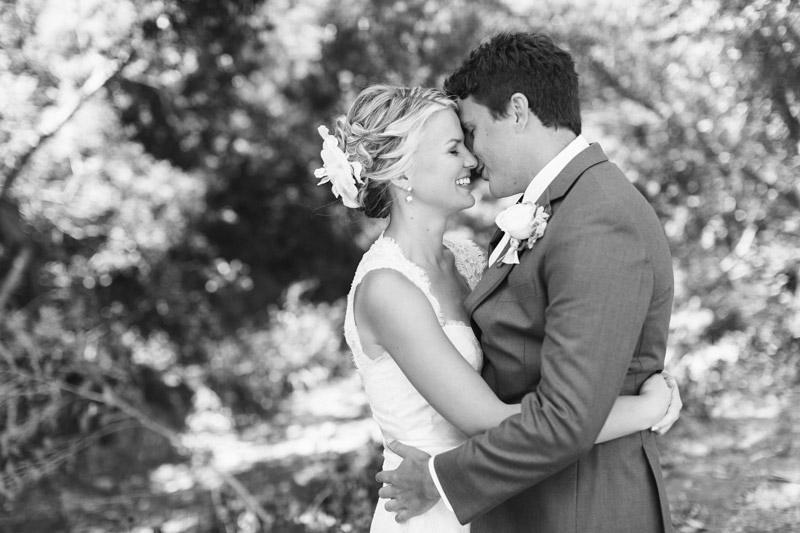 Cayucos Creek, bride and groom hugging