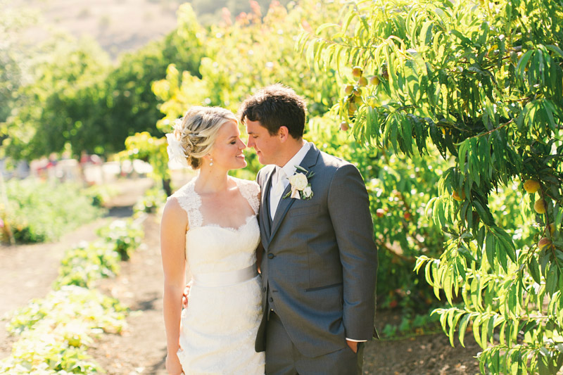 Cayucos creek barn, couple in fruit orchard