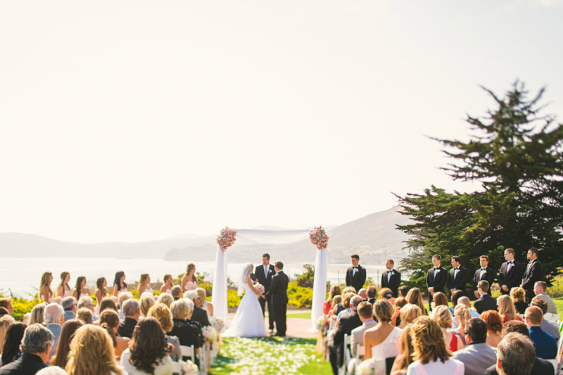 Shell Beach, bride and groom getting married // ocean in the background