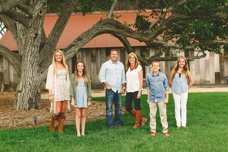 (Greengate Ranch) family standing in front of tree